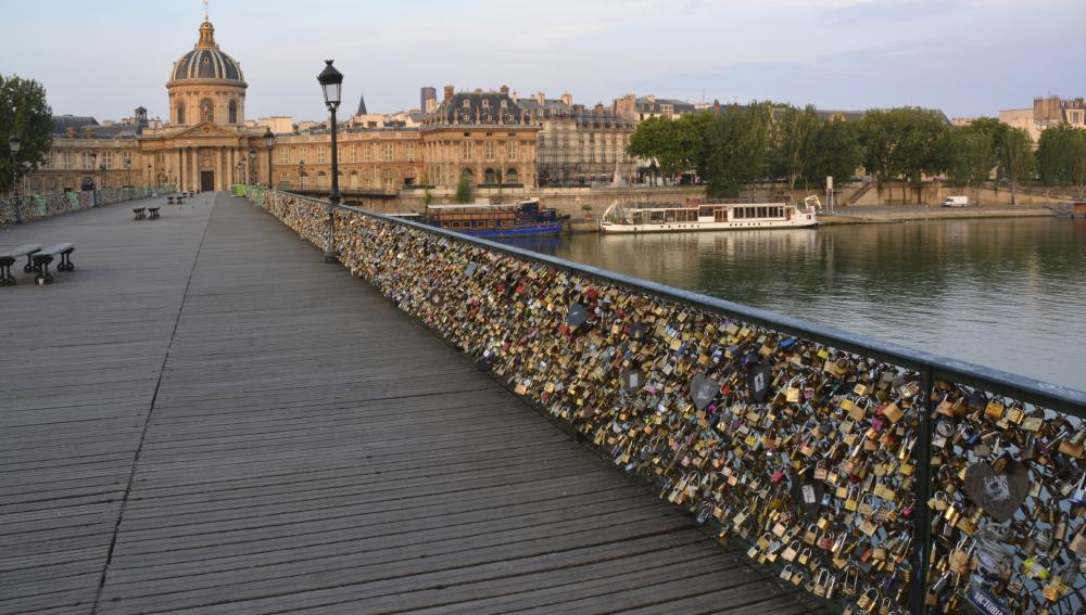 The hundreds of thousands of love inscribed padlocks on the Pont Des Arts Bridge, Paris France.